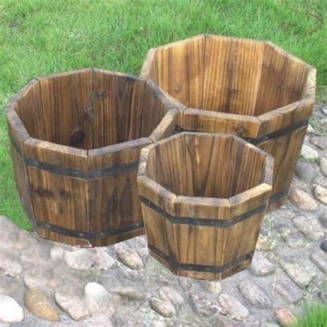 Large Wooden Barrel Planters by Wooden Barrel Planter Set Wood Large Planters Gardening