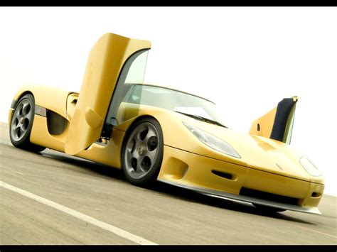 koenigsegg yellow sls amg gullwing doors vs lambo murci doors
