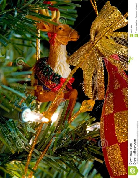 circus raindeer christmas decoration on a tree stock
