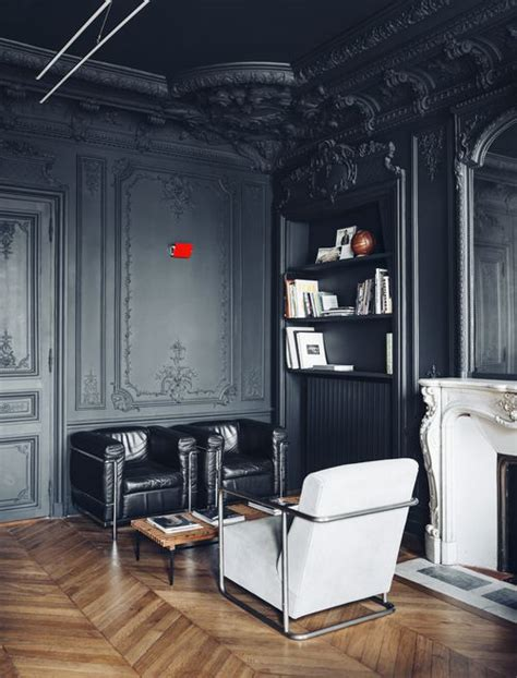 gorgeous dark walls and high ceilings with minimal but traditional statement furniture pieces 26 gorgeous living rooms with black walls digsdigs