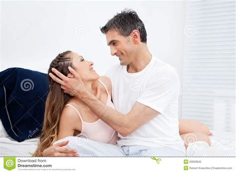 cuddle in bed married couple cuddling in bed stock photo image 23003840