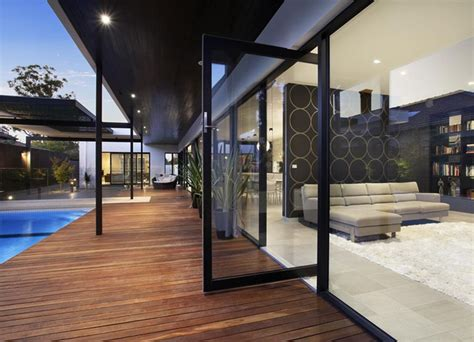 beautiful Modern House With Pool #2: Large-glass-doors-that-connect-the-patio.jpg