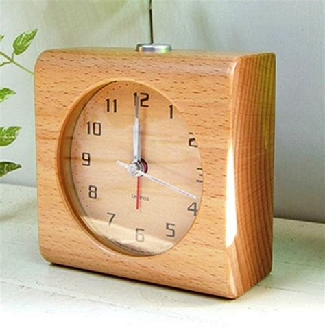 lemnos design alarm clock block carved from a solid block of wood wilhelmina designs