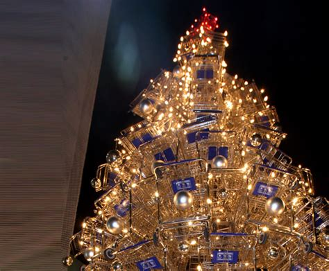 this towering holiday tree is made of 86 shopping carts