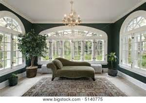 picture or photo of sunroom in luxury home with sofa and wall of windows