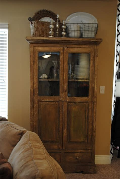 decorating armoire tops 66 best images about cabinet top decorating on pinterest
