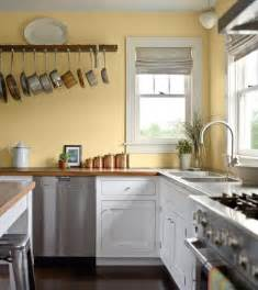 Colour Ideas For Kitchen Walls by Pale Yellow Walls White Cabinets Wood Counter Tops