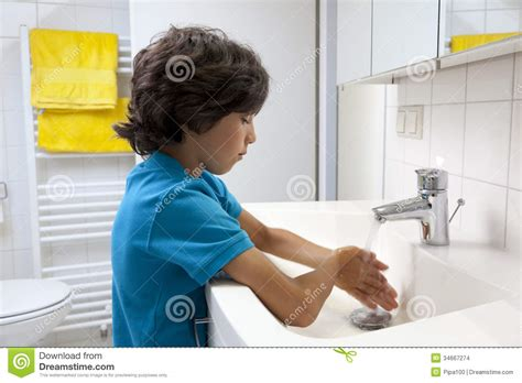 wash the bathroom little boy washing his hands stock photo image 34667274
