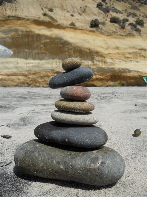 stacking stones stacking bones stand and face the sun