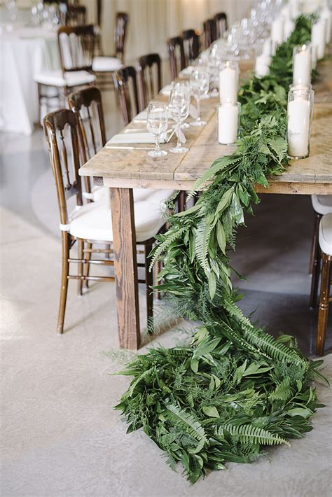 Wedding Aisle With Tables by Simple Table Garland With Leafy Greens Fern Tablescape