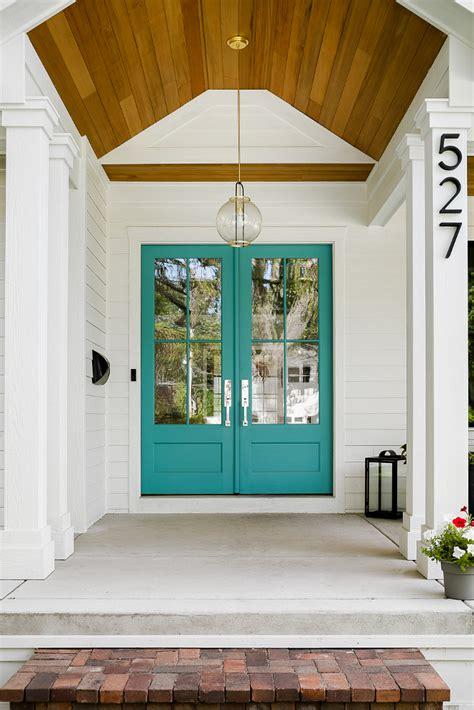 white farmhouse  wrap  porch home bunch