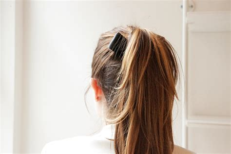 bow in her hair and rear view learn to do a black tie ponytail in a jiffy with gifs