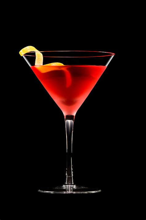 cosmopolitan drink png cosmopolitan cocktail in front of a black background