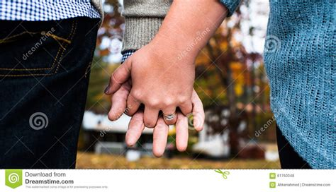 With These Rings We Do by With These Rings We Begin Our Lives Together Stock Photo