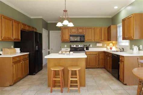 designer kitchen  oak cabinets  black granite