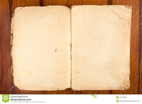 opened old softcover book on a wooden background stock