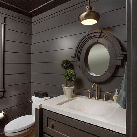 were highlighting these gorgeous black shiplap walls in