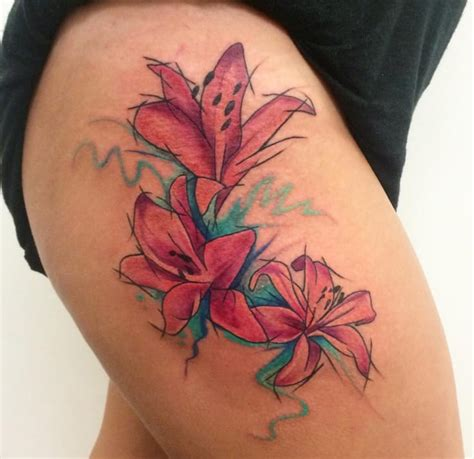 watercolor lily tattoo 14 splendid watercolor flower tattoos tattoodo