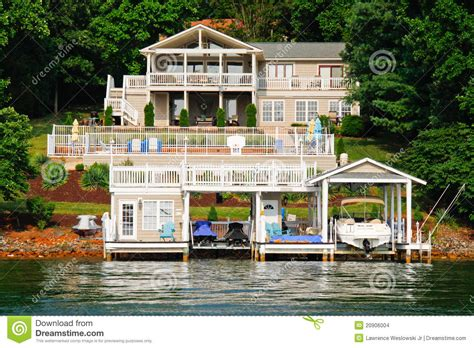 A Frame Lake House Plans waterfront house pool boats jet skis stock images