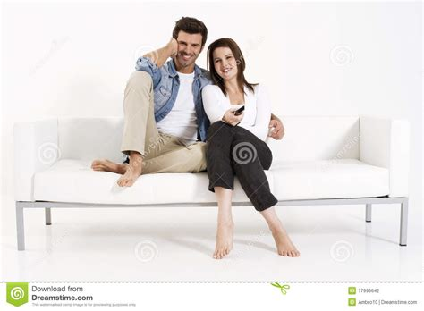 couples having on the couch couple on the couch watching tv stock photography image
