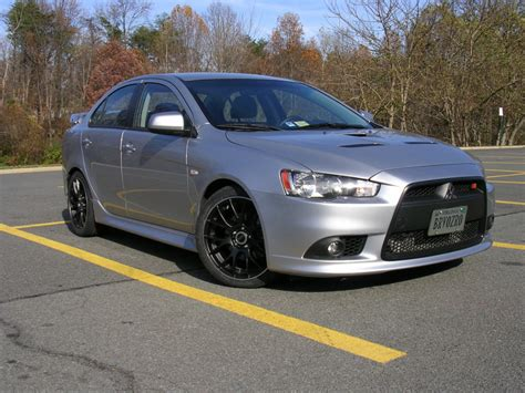 silver mitsubishi lancer black rims mitsubishi lancer evolution custom wheels bremmer kraft