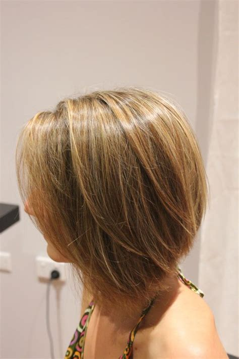 hair cutting techniques for concave concave bob with a mix of blonde caramel and hazelnut