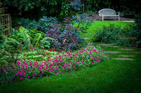 floral garden walk and park bench photograph by gene sherrill