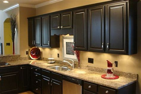 painting kitchen cabinets dark brown would you paint your kitchen cabinets black