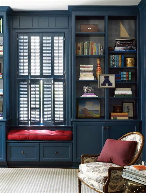 window seat flanked by bookcases window seat with shuttered windows flanked by bookcases