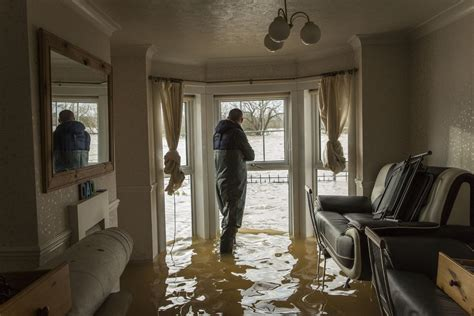 flooded room uk weather residents battle to save their possessions in flooded homes pictures huffpost uk