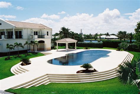 Florida House Designs deck level pools custom swimming pool and spas palm
