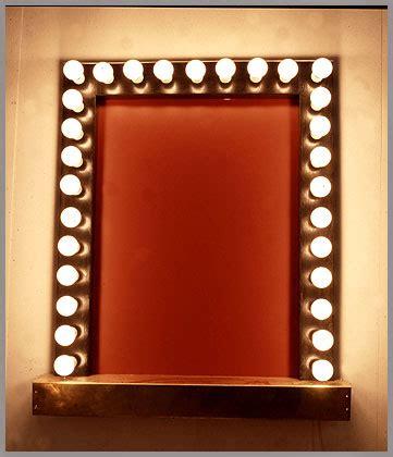 Vanity Mirror With Light Bulbs Around It by Dressingroom Fashion