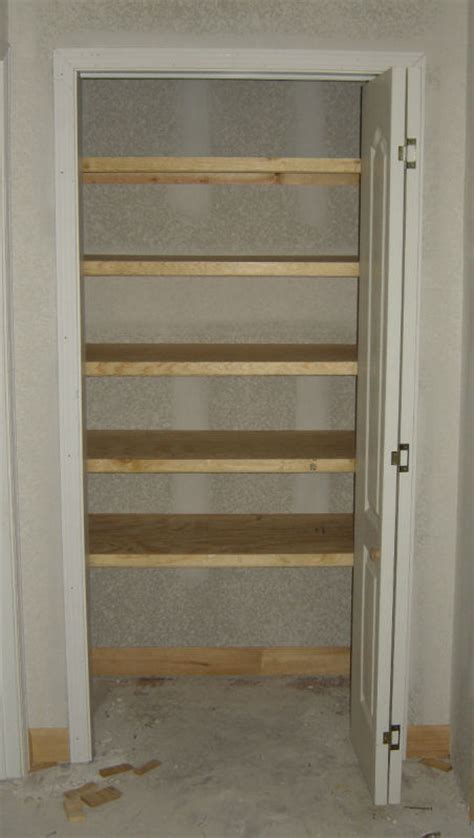Linen Closet Shelving by Trim