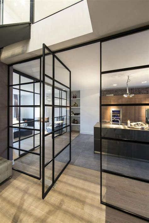 Pivot Interior by 10 Exles Of Homes With Large Pivoting Doors Contemporist