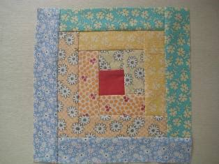 beginner log cabin block quilting tutorial from