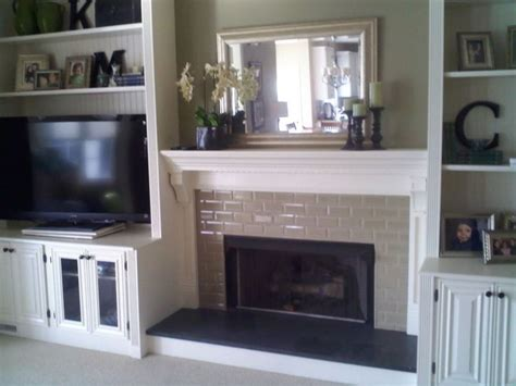 hand crafted painted built in tv cabinetry by tony o fireplace with built in bookshelves custom trimwork