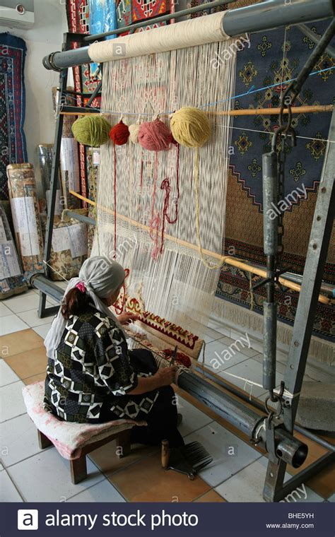 rug weaving machine a or weaving a carpet or rug at kairouan tunisia stock photo royalty free