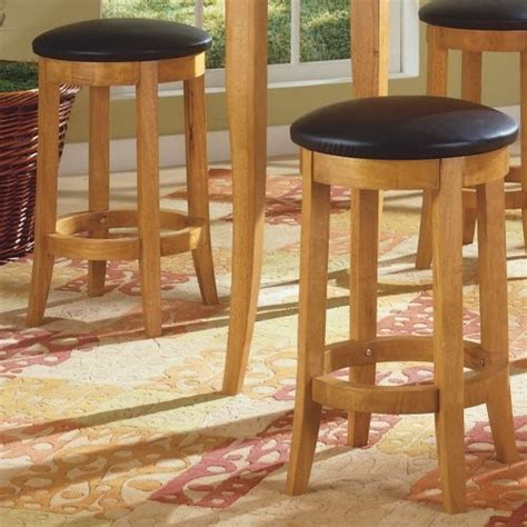honey oak bar stools eliza 24 in honey oak with black vinyl swivel counter