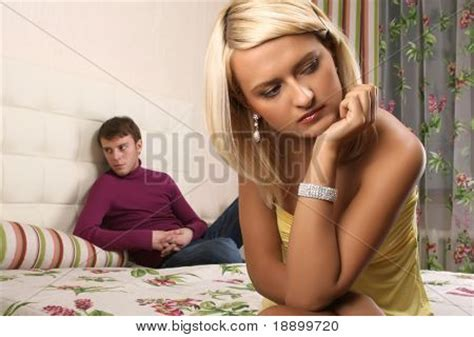 man and woman in the bedroom young beautiful woman and man argue in bedroom stock photo
