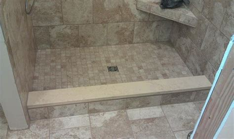 capping shower curb with the same quartz being used on the