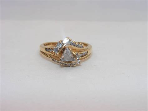 trillion cut solitaire engagement ring 14k yellow