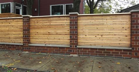 wood fence with brick columns garden wood