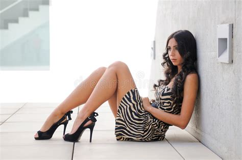 hot funny photos download funny female model at fashion sitting on the floor stock