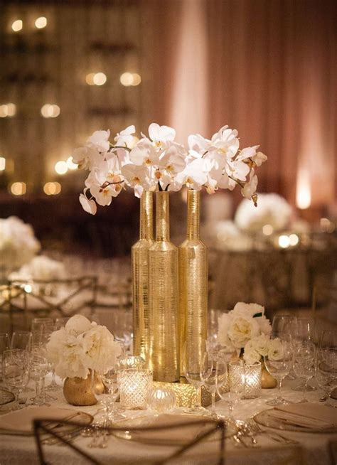 Gold centerpieces, Gold and Black feathers on Pinterest