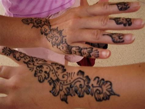 hand and wrist tattoos grey ink henna on and wrist