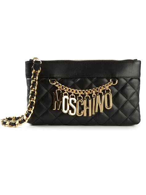 moschino quilted chain clutch in black lyst