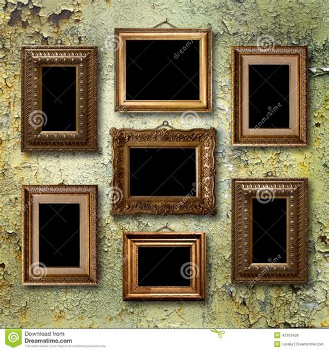 Country Bathroom Decor gilded wooden frames for pictures on old rusty wall stock