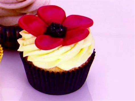 orange sleepy poppy cupcake with spiked orange cream