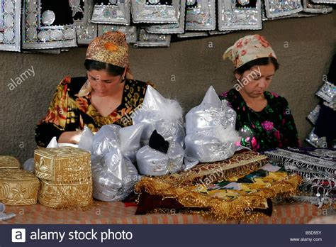 uzbek women selling traditional wedding skullcaps and dresses sunday uzbek women selling traditional wedding skullcaps and