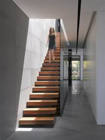 stairs in house stairs of house that looks minimalistic outside but